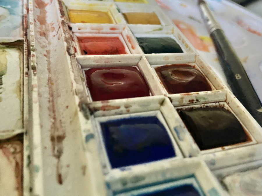 Watercolor+paints+rest+in+a+pallet.+Watercolors+are+dried+blocks+of+paint+that+can+be+reused+over+and+over+again.+%28Hera+Pokheral%29