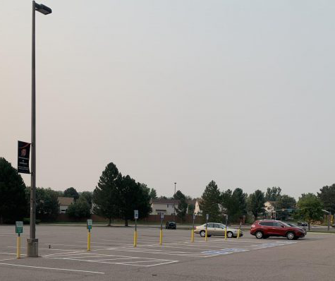 A near empty parking lot—an unusual sight at Rangeview High School. Many students have expressed their dislike for online school, but there aren't many options for schooling right now. (Bowman)
